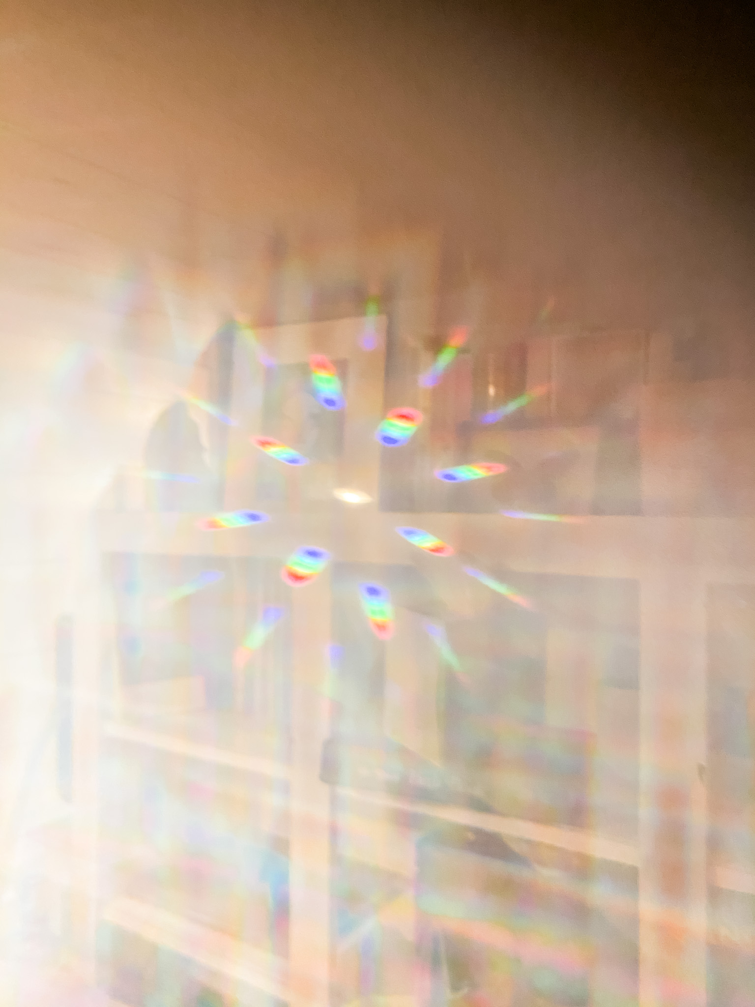light diffracting into rainbow prisms