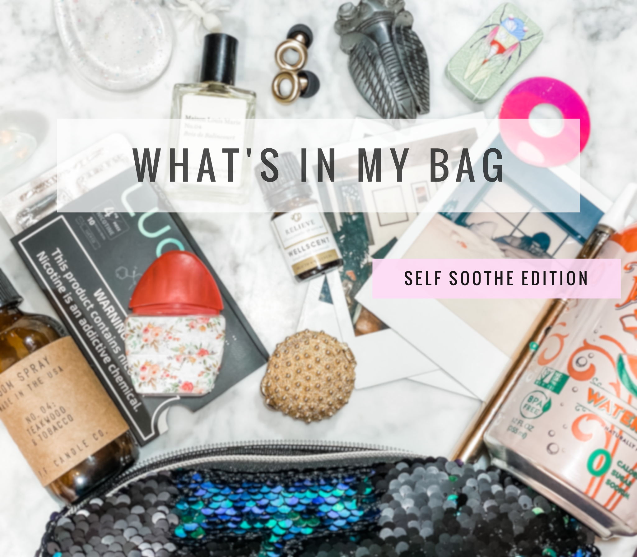 "items splayed out of a bag on marble background with text ""whats in my bag self soothe edition"""